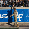 An Army West Point officer high-fives crowd members at Falcon Stadium on Saturday, Nov. 4, 2017.