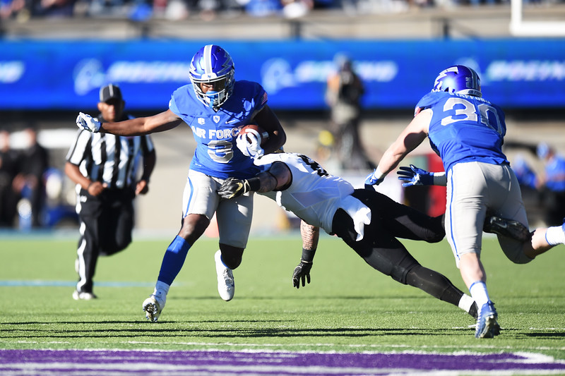 Air Force Falcons wide receiver Ronald Cleveland (3) runs the ball as Army Black Knights defensive back Rhyan England (8) fails to stop him at Falcon Stadium on Saturday, Nov. 4, 2017. Cleveland was brought down a short gain later.