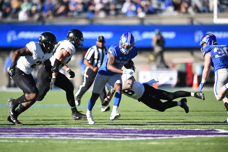 Air Force Falcons wide receiver Ronald Cleveland (3) runs through a gauntlet of Army West Point Black Knights for a short gain at Falcon Stadium on Saturday, Nov. 4, 2017. The Black Knights defeated the Falcons 21-0.