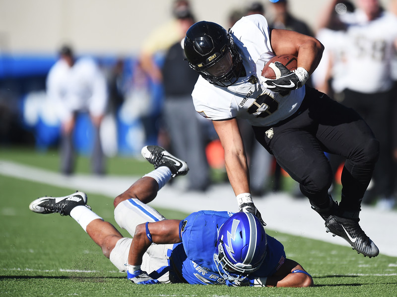 Army Black Knights running back Darnell Woolfolk (33) slams Air Force Falcons defensive back James Jones (4) into the ground before being shoved out of bounds at Falcon Stadium on Saturday, Nov. 4, 2017. The Black Knights shut out the Falcons 21-0.