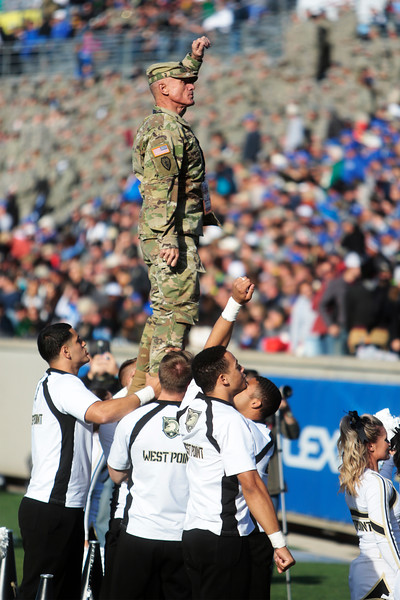 An Army West Point officer leads a cheer while held up by West Point cheerleaders at Falcon Stadium on Saturday, Nov. 4, 2017. The West Point Black Knights defeated the Air Force Falcons 21-0.