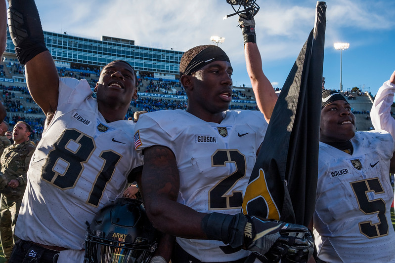 Army Black Knights wide receiver Jeff Ejekam (81), Army Black Knights defensive back James Gibson (2) and Army Black Knights running back Kell Walker (5) cheer after singing their Alma Mater at Falcon Stadium on Saturday, Nov. 4, 2017. The Black Knights defeated the Air Force Falcons 21-0.