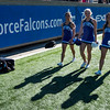 Air Force cheerleaders walk down the field before the game starts at Falcon Stadium on Saturday, Nov. 4, 2017.