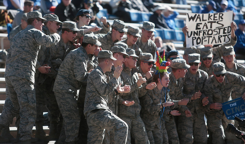 Air Force cadets cheer for a television camera, one wearing the remains of a piñata meant to represent Army West Point, before the game at Falcon Stadium on Saturday, Nov. 4, 2017. The Army West Point Black Knights defeated the Air Force Falcons 21-0.