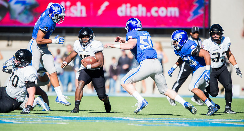 Army Black Knights quarterback Ahmad Bradshaw (17) runs upfield as Air Force Falcons linebacker Lakota Wills (8) and Air Force Falcons linebacker Jack Flor (50) pounce on him at Falcon Stadium on Saturday, Nov. 4, 2017. The Black Knights lead 14-0 at half time.