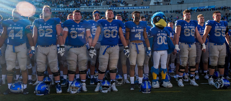 Air Force Falcons hold hands while singing the Alma Mater at Falcon Stadium on Saturday, Nov. 4, 2017. The Falcons where shut out for the first time since they lost the Liberty Bowl in 1992.