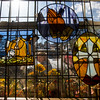 """A woman walks past a window displaying stained glass artwork by Frank """"Mike"""" Robertson and Gregory Robertson at the Black Forest Arts and Crafts Guild fall boutique at the Black Forest Community Hub, Sunday, November 5, 2017. The four day boutique started Thursday and ran through Sunday."""