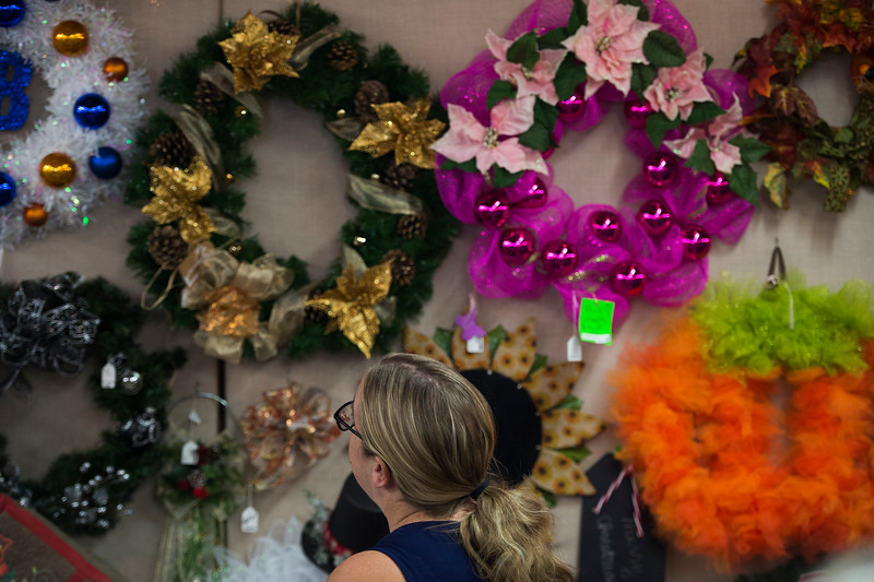 Robin Billiu looks at colorful wreathes at the Black Forest Arts and Crafts Guild fall boutique at the Black Forest Community Hub, Sunday, November 5, 2017. The fall boutique is an annual tradition in its 53rd year.