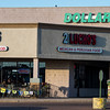 A man walks by the busy restaurant 2 Lucho's in the Hancock Plaza shopping center in Southeast Colorado Springs. Photographed Sunday, November 5, 2017.