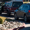 A woman drops off her early ballot at the East Library while a line of cars waits for their turn on Monday, November 6, 2017.