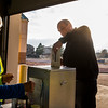Firefighter Roger Lance casts his early vote at a mobile drop box in the Wescott Fire Protection District Headquarters on Monday, November 6, 2017. Lance was the first voter to drop off his ballot at the mobile station, a new initiative this year .