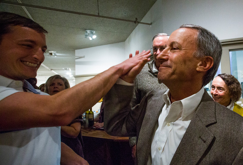 Ken Jaray receives a high five from his son Ian Jaray after being announced the early winner of the election for mayor of Manitou Springs on Tuesday, November 7, 2017.