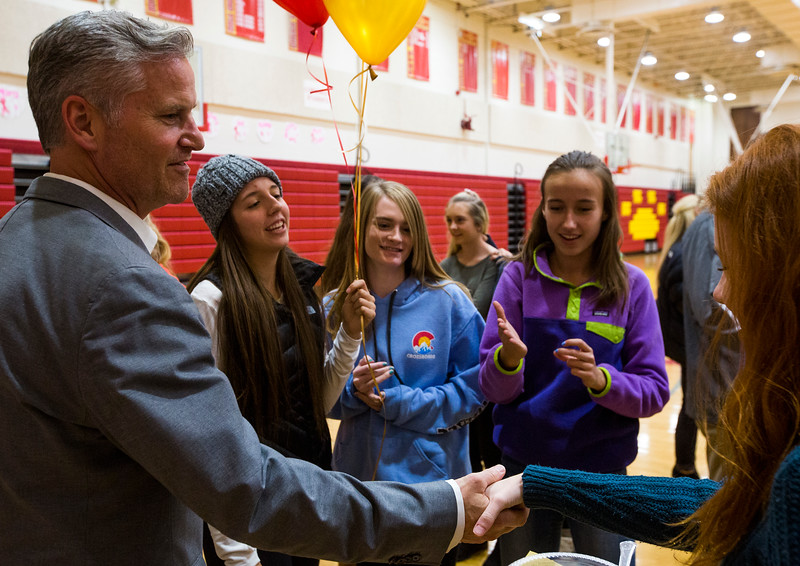 Darin Smith, Coronado High School principal, shakes hands with students at a signing ceremony for student athletes at the high school gym on Wednesday, November 8, 2017.