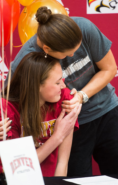 Coach Stormie Wells hugs Mara Abernethy at a signing event in the Coronado High School Gym on Wednesday, November 8, 2017. Abernethy signed her letter of intent to go on to the University of Denver as a volleyball player.