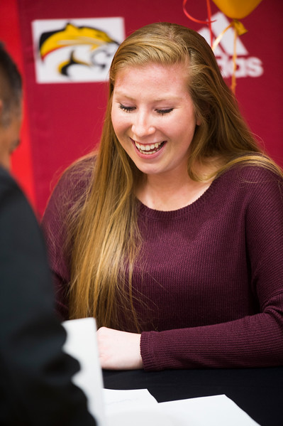 Erica Burkhart laughs after signing her letter of intent in the Coronado High School Gym on Wednesday, November 8, 2017. Burkhart will play softball at Colorado Northwestern Community College after graduation.
