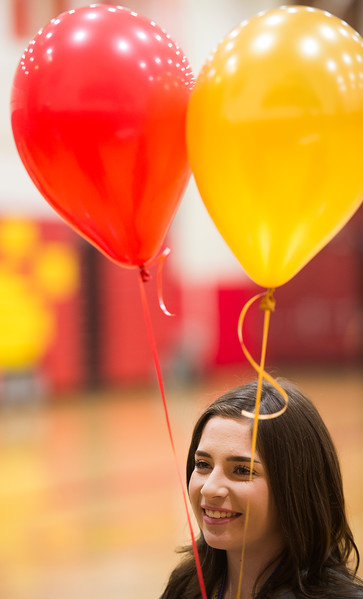 Savannah Leifer holds balloons in Coronado High School colors after a ceremony where she signed a letter of intent to play tennis at Colorado Mesa University on Wednesday, November 8, 2017.