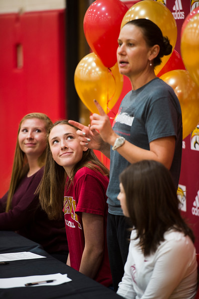Mara Abernethy watches her coach, Stormie Wells, talk about her time on the volleyball team at a signing event on Wednesday, November 8, 2017. Abernethy signed her letter of intent to go to University of Denver.