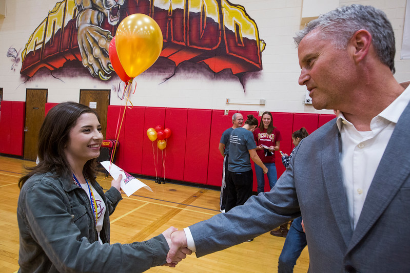 Savannah Leifer shakes hands with principal Darin Smith after signing her letter of intent for Colorado Mesa in the Coronado High School Gym on Wednesday, November 8, 2017. Leifer played women's tennis for Coronado and will continue in college.