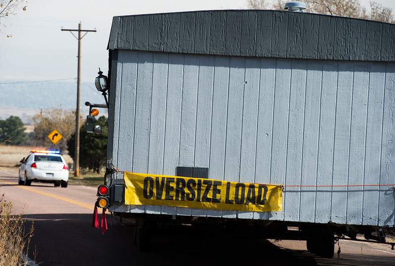 The El Paso Sheriff's department removed a derelict mobile home from the street outside Cheyenne Mountain Estates in Colorado Springs, Colo. on Friday, Nov. 10, 2017.
