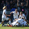 Air Academy Kadets players pike on to midfielder Ryan Self (15) after he scored an overtime goal to defeat the Centaurus Warriors 1-0 at Dick's Sporting Goods Field in Denver, Colo. on Saturday, Nov. 11, 2017. The Kadets are the Colorado 4A state champions.