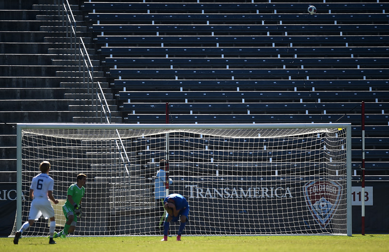 Air Academy Kadets keeper Thomas Beatty (1) rises from a dive as Centaurus Warriors defender Cristian Rice (4) holds his head in his hands after sending a penalty kick into the stands above the goal at Dick's Sporting Goods Field in Denver, Colo. on Saturday, Nov. 11, 2017. The Kadets defeated the Centaurus Warriors 1-0 in overtime to become the Colorado 4A state champions.
