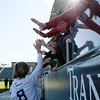 Air Academy Kadets defender Andrew Hess (8) gives high-fives down a row of fans at Dick's Sporting Goods Field in Denver, Colo. on Saturday, Nov. 11, 2017. The Kadets defeated the Centaurus Warriors 1-0 in overtime are the Colorado 4A state champions.