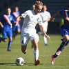 Air Academy Kadets forward Thaddaeus Dewing (4) dribbles the ball as Centaurus Warriors defender Jack Bilello (7) chases him at Dick's Sporting Goods Field in Denver, Colo. on Saturday, Nov. 11, 2017. The Kadets defeated the Centaurus Warriors 1-0 in overtime and are the Colorado 4A state champions.
