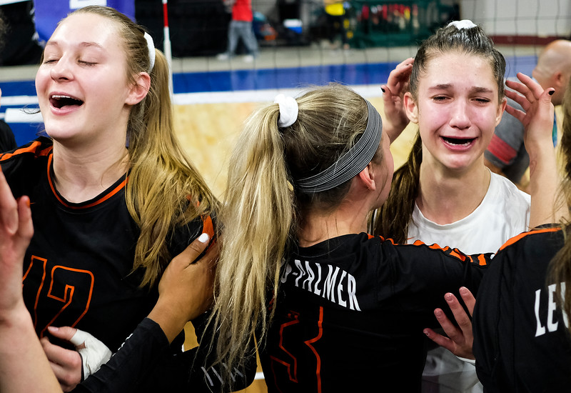Lewis-Palmer Rangers' Kennedy Shelley (12) laughs after winning as Gianna Bartalo (17) cries tears of happinessat the Denver Coliseum on Saturday, November 11, 2017. The Rangers defeated the Valor Christian Eagles 3-0 after a 35-33 third set.<br /> <br /> (The Gazette, Nadav Soroker)