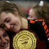 Lewis-Palmer Rangers Adelaide Feel (9), center, hugs Kennedy Shelley (14) while holding the championship trophy at the Denver Coliseum on Saturday, November 11, 2017. The Rangers defeated the Valor Christian Eagles 3-0 to clinch the state championship.<br /> <br /> (The Gazette, Nadav Soroker)