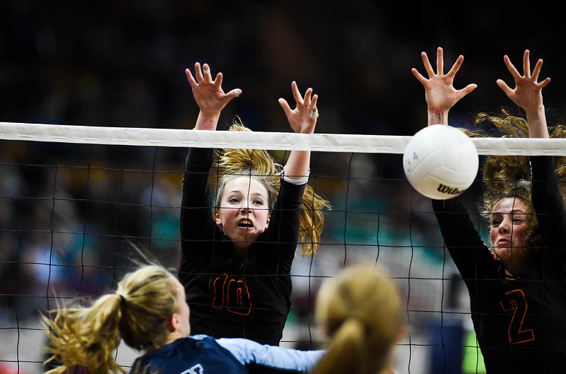Lewis-Palmer Rangers Riley Putnicki (10) and Kessandra Krutsinger (2) block the Valor Christian Eagles before winning the state championship 3-0 at the Denver Coliseum on Saturday, November 11, 2017.<br /> <br /> (The Gazette, Nadav Soroker)