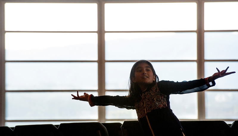 "Rucha Katdhare, 10, holds her arms outstretched in the ending moments of a dance during rehearsals for ""Pyaar... Expressions of Love"" at the Fellowship Bible Church on Sunday, November 12, 2017. The performance is part of the local Indian communities annual Diwali celebrations and also a fundraiser, this year for the Court Appointed Special Advocates.<br /> <br /> (The Gazette, Nadav Soroker)"