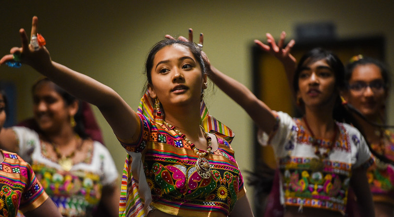 "Rhea Shrestha, 13, stretches out a hand with unlit LED lights during rehearsal dances for the ""Pyaar... Expressions of Love"" performance, at the Fellowship Bible Church on Sunday, November 12, 2017. The performance is part of the local Indian communities annual Diwali celebrations and also a fundraiser, this year for the Court Appointed Special Advocates.<br /> <br /> (The Gazette, Nadav Soroker)"