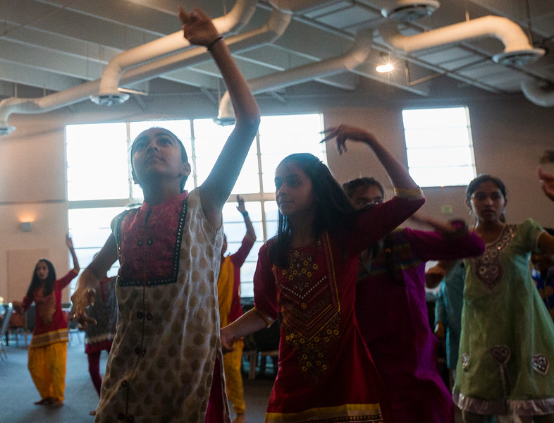 "Naisha Nail, 12, smoothly raises her arm during a rehearsal dance at the Fellowship Bible Church on Sunday, November 12, 2017. The rehearsal is for ""Pyaar... Expressions of Love,"" by the local Indian communities annual Diwali celebrations and also a fundraiser, this year for the Court Appointed Special Advocates.<br /> <br /> (The Gazette, Nadav Soroker)"