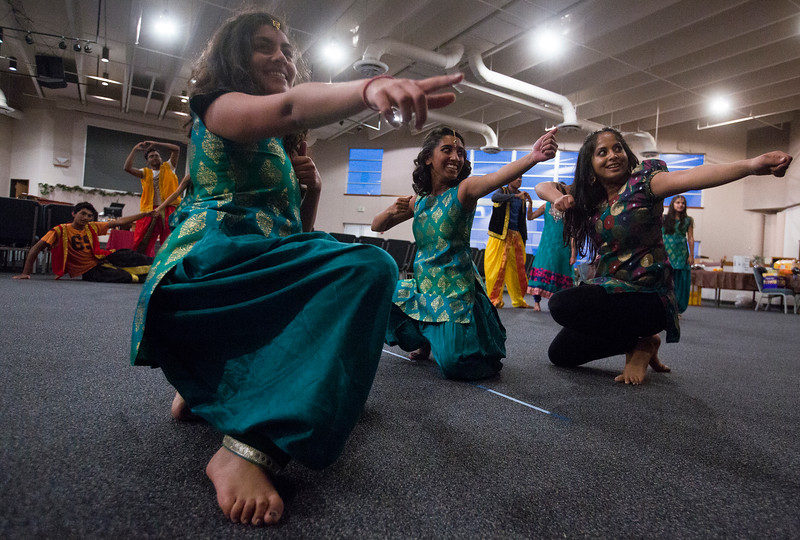 "Noopur Naik, 18, Neha Kollikara, 18, and Nethra Vishwaroopan, 18, mimic bows and arrows in the ending pose of their dance during a rehearsal for ""Pyaar... Expressions of Love"" at the Fellowship Bible Church on Sunday, November 12, 2017. The performance is part of the local Indian communities annual Diwali celebrations and also a fundraiser, this year for the Court Appointed Special Advocates.<br /> <br /> (The Gazette, Nadav Soroker)"
