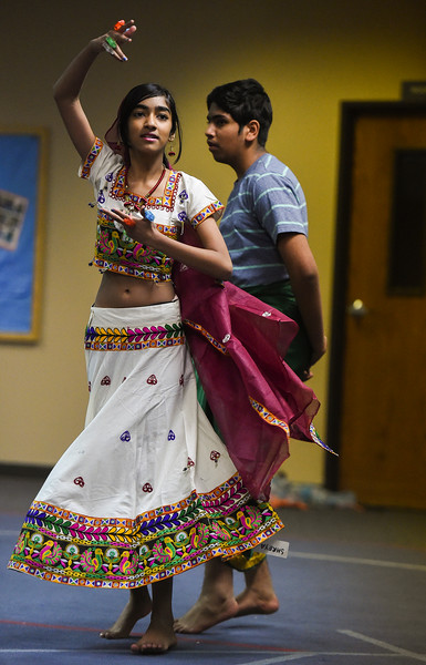 "Shreya Krishnan, 13, and Tejas Satishkumar, 14, rehearse the dance they are a part of in ""Pyaar... Expressions of Love,"" a performance by the local Indian community, at Fellowship Bible Church on Sunday, November 12, 2017. The performance is part of the local Indian communities annual Diwali celebrations and also a fundraiser, this year for the Court Appointed Special Advocates.<br /> <br /> (The Gazette, Nadav Soroker)"