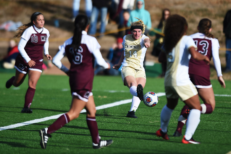 UCCS Mountain Lions midfielder Kelsey Lanham (14) passes the ball at Mountain Lion Stadium in Colorado Springs, Colo. on Sunday, November 12, 2017. The Mountain Lions won 1-0 to continue in the NCAA Division II soccer championship, their next opponent is the Colorado School of Mines.<br /> <br /> (The Gazette, Nadav Soroker)