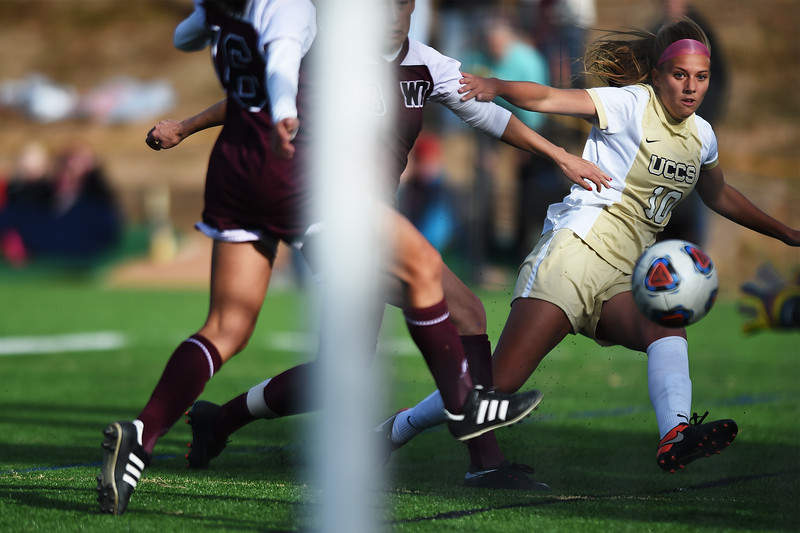 UCCS Mountain Lions midfielder Tarah Patterson (10) attempts a shot on goal while being chases by two defenders at Mountain Lion Stadium in Colorado Springs, Colo. on Sunday, November 12, 2017. The Mountain Lions won 1-0 to continue in the NCAA Division II soccer championship, their next opponent is the Colorado School of Mines.<br /> <br /> (The Gazette, Nadav Soroker)