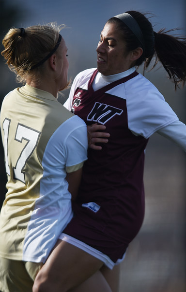 UCCS Mountain Lions forward Tori Maydew (17) collides with West Texas A&M Lady Buffs midfielder Samantha Silvestre (16) in the fight for the ball at Mountain Lion Stadium in Colorado Springs, Colo. on Sunday, November 12, 2017. The Mountain Lions won 1-0 to continue in the NCAA Division II soccer championship, their next opponent is the Colorado School of Mines.<br /> <br /> (The Gazette, Nadav Soroker)