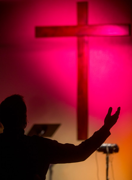 Danny Garrido raises his arms in worship during a song at the beginning of the service at The Crossing Church in Colorado Springs, Sunday, Sept. 17, 2017.<br /> <br /> (The Gazette, Nadav Soroker)