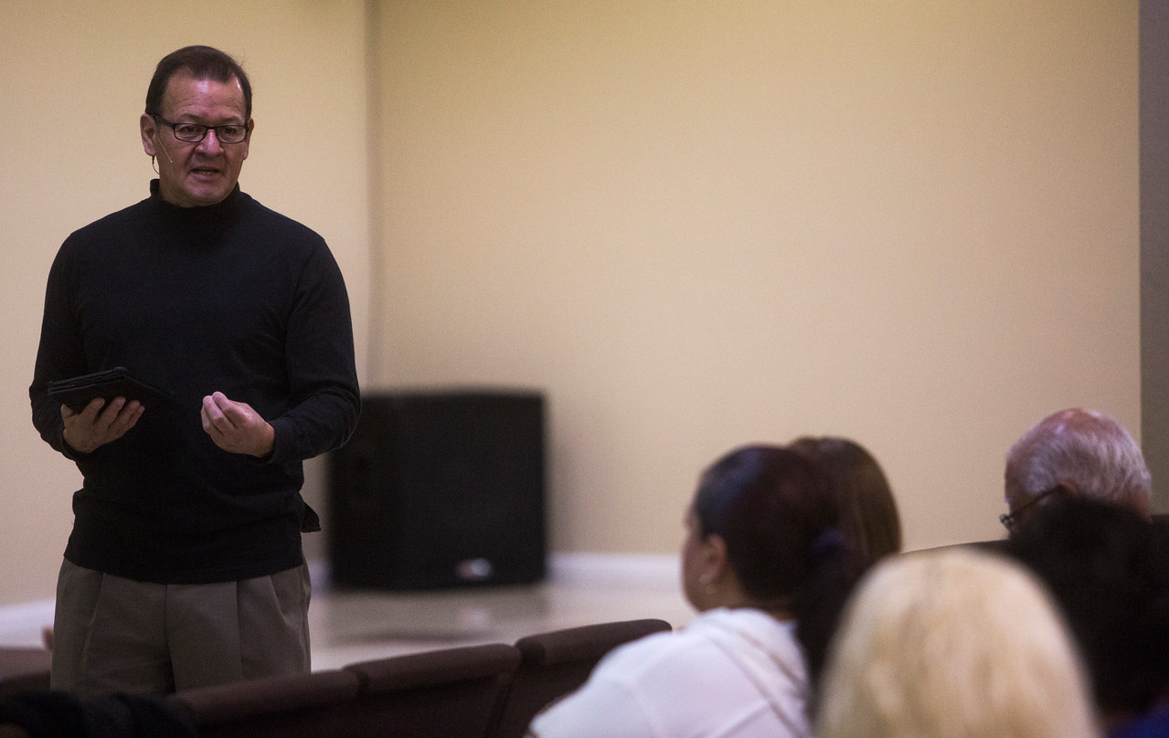 Danny Garrido leads the service as the pastor at The Crossing Church which he does while also a Sales Tax Investigator for the city of Colorado Springs, Sunday, Sept. 17, 2017.<br /> <br /> (The Gazette, Nadav Soroker)