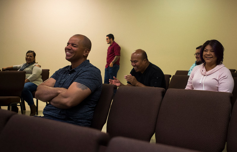 Emanuel Otero, front, laughs at Pastor Danny Garrido's joke during service at The Crossing Church in Colorado Springs, Colo. on Sunday, Sept. 17, 2017.<br /> <br /> (The Gazette, Nadav Soroker)