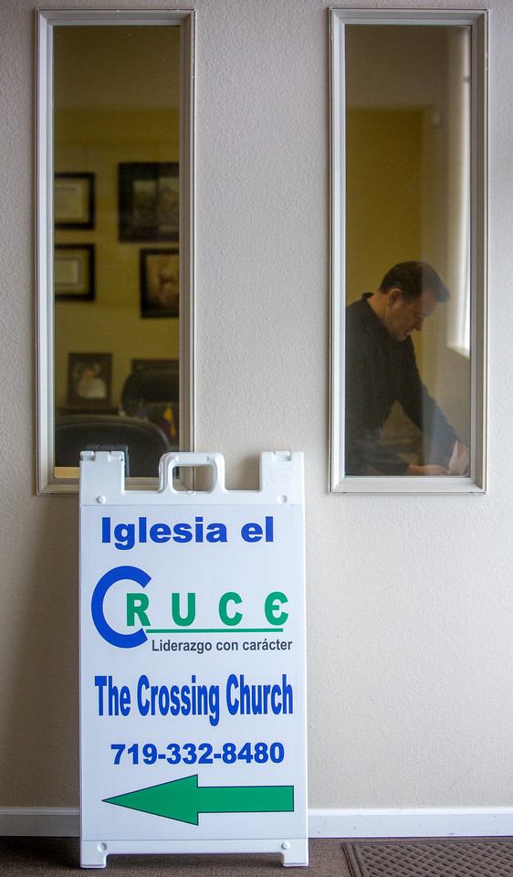 Danny Garrido gathers up junk mail in his office at The Crossing Church in Colorado Springs, Colo. on Sunday, Sept. 17, 2017. Garrido started the church in his house.<br /> <br /> (The Gazette, Nadav Soroker)