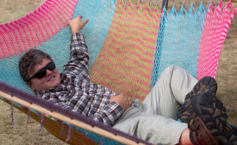 Chris Sawyer reclines in a hammock he made at Rock Ledge Ranch in Colorado Springs, Sunday, Sept. 17, 2017. Sawyer was selling hammocks at the Holly Berry Folk Art Festival.<br /> <br /> (The Gazette, Nadav Soroker)