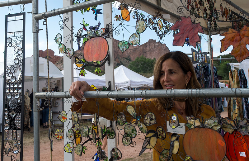 Loretta Mertz removes tags from her display at the Holly Berry House Folk Art Festival at Rock Ledge Ranch in Colorado Springs, Sunday, Sept. 17, 2017. Mertz has been working with glass for over two decades.<br /> <br /> (The Gazette, Nadav Soroker)
