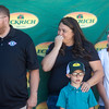 Daniel, left, Angela, Hunter, 8, and Ariana Walter, 16, hear that they are being given a new Ford Fusion outside of Safeway in Fountain, Colo. on Monday, Sept. 18, 2017. <br /> <br /> (The Gazette, Nadav Soroker)