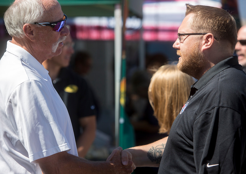 Goose Gossage shakes hands with Daniel Walter outside of Safeway in Fountain, Colo. on Monday, Sept. 18, 2017. Gossage drove up to the stage in the new Ford Fusion that was given to the Walters.<br /> <br /> (The Gazette, Nadav Soroker)