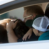 Daniel Walter holds his wife Angela in their new Ford Fusion outside of Safeway in Fountain, Colo. on Monday, Sept. 18, 2017. The Walters were given the new car by Safeway and Eckrich.<br /> (The Gazette, Nadav Soroker)