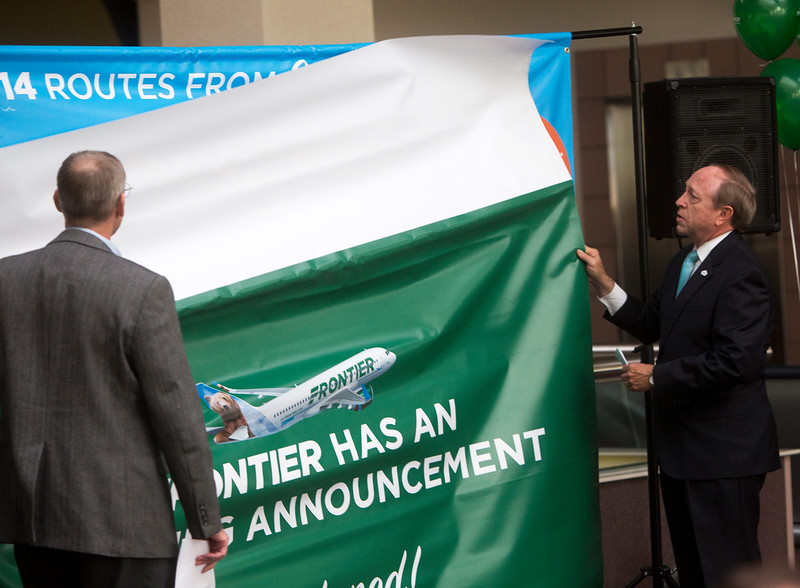 Colorado Springs Mayor John Suthers, right, and Rick Zeni, Frontier Airlines chief information officer, unveil a map with all the Frontier flights that will be available at Colorado Springs' airport on Monday, Sept. 18, 2017. <br /> <br /> (The Gazette, Nadav Soroker)