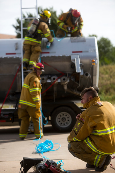 Firefighter Chris Kenner monitors air pressure for a pneumatic drill as his crew practices an emergency response to an overturned tanker at CSFD Headquarters in Colorado Springs, Colo. on Friday, Sept. 22, 2017. All the firefighters at the training were Hazardous Materials Technicians.<br /> <br /> (The Gazette, Nadav Soroker)