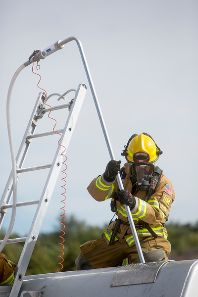 A firefighter practices extracting a hazardous material from the back of a damaged tanker at CSFD headquarters in Colorado Springs, Colo. on Friday, Sept. 22, 2017. Firefighters may need to isolate or remove dangerous materials from a scene to make sure that they don't interact and create worse situations.<br /> <br /> (The Gazette, Nadav Soroker)